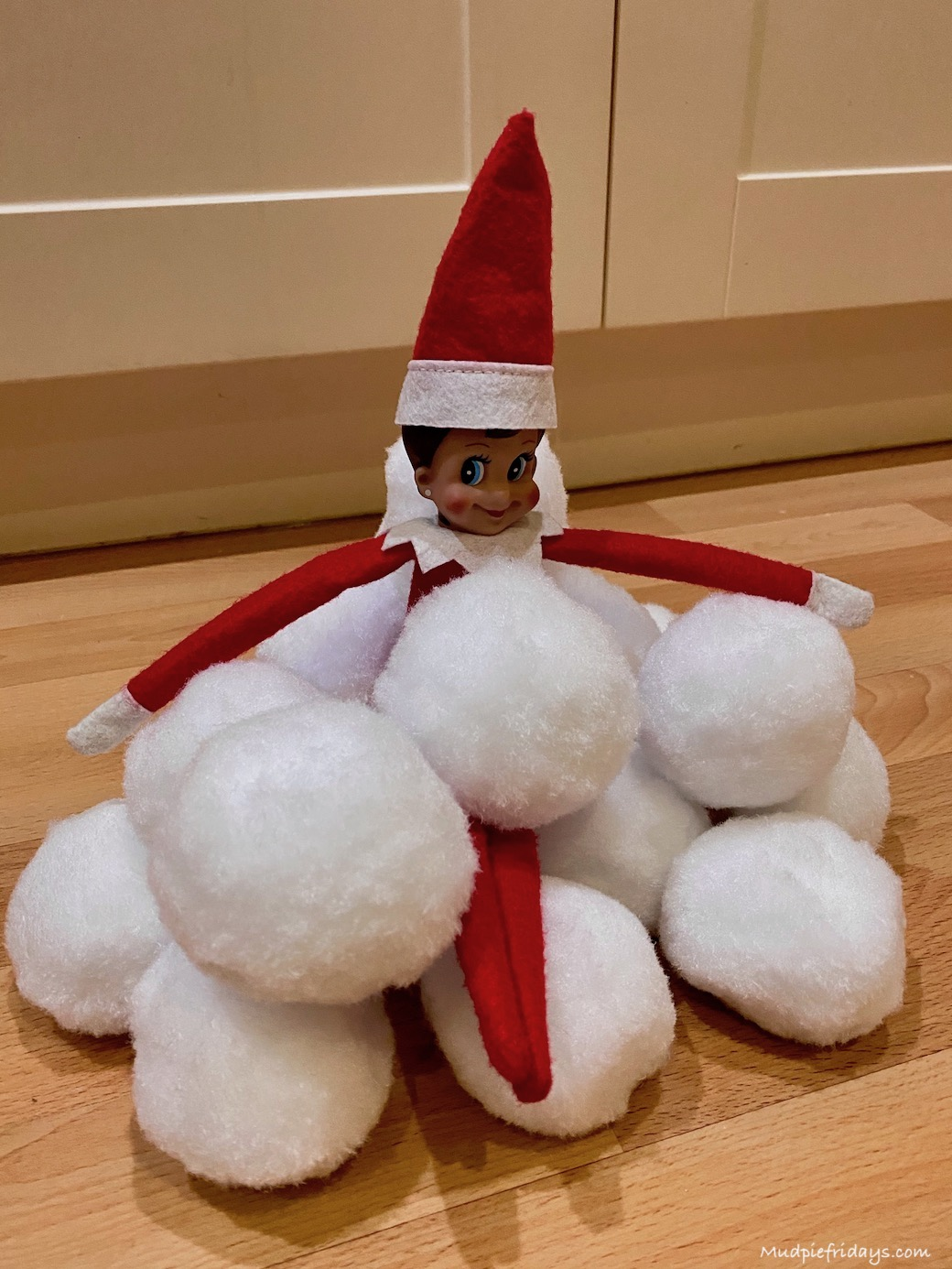 Elf on the shelf with snowballs