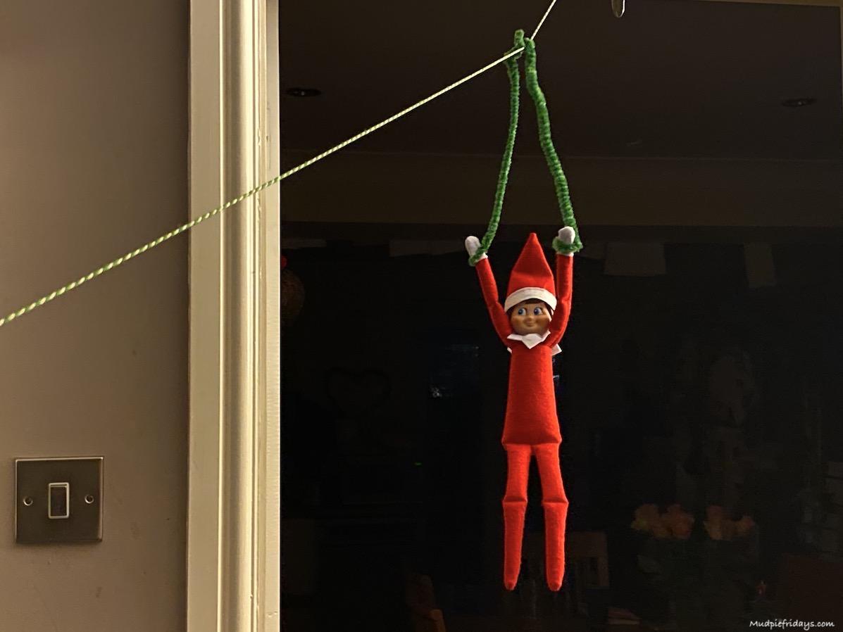 Zip lining elf on the shelf